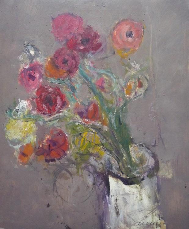 Bouquet de fleurs au vase blanc