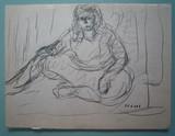 Jeune femme assise à l'atelier