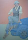 Le garçon sur la voiture bleue