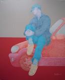 Le garçon sur la voiture rouge